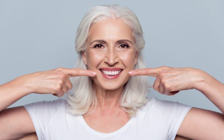 Elderly Woman Pointing At New Implants