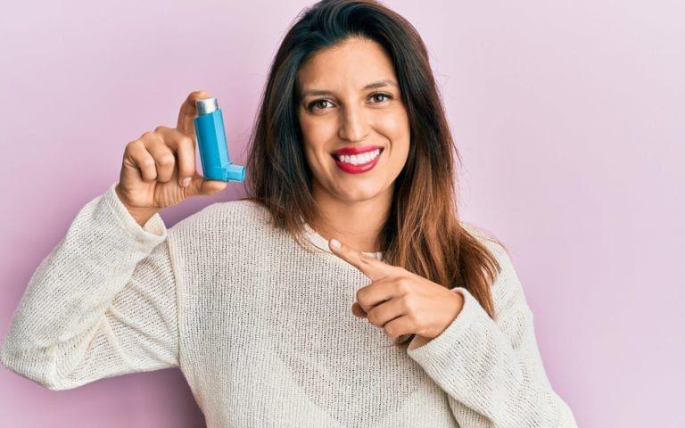 Woman Holding Asthma Inhaler